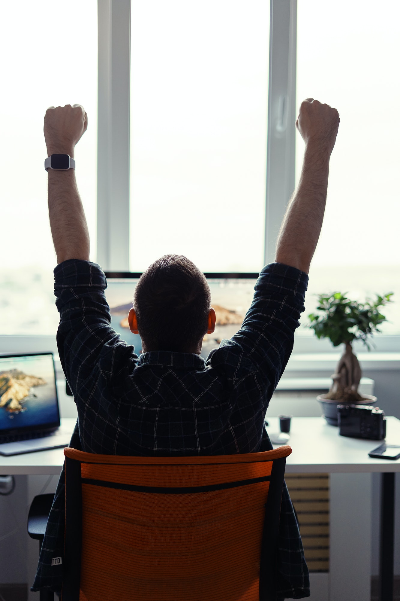 victorious-man-celebrating-his-success-in-his-work-place-1.jpg